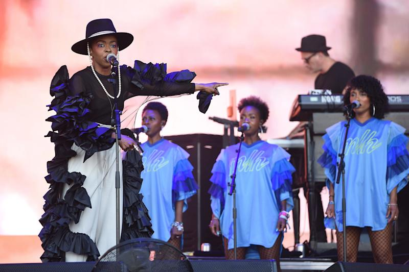 Lauryn Hill performs at Glastonbury in Roberts-Wood's hand-made, hand-linked, non-stitch black ruffle dress.