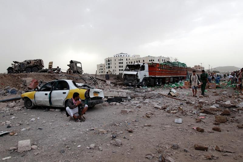 Huthi militants gather at the site of an air-strike by the Saudi-led coalition, in Sanaa on July 14, 2015 (AFP Photo/Mohammed Huwais)