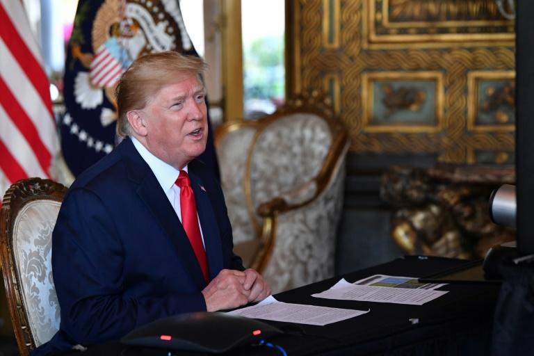 US President Donald Trump talks to reporters at his Mar-a-Lago estate in Palm Beach, Florida, on December 24, 2019