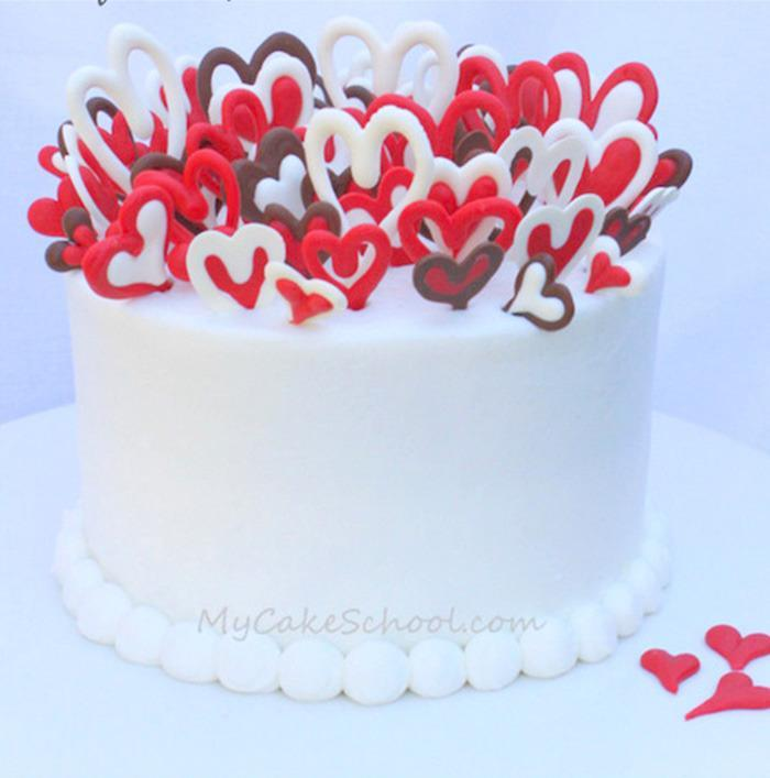 """<p>The finished effect on this bake is surprisingly elegant - and easy to achieve. <i>[Photo: <a href=""""http://www.mycakeschool.com/blog/lots-of-love/"""" rel=""""nofollow noopener"""" target=""""_blank"""" data-ylk=""""slk:My Cake School"""" class=""""link rapid-noclick-resp"""">My Cake School</a>]</i></p>"""