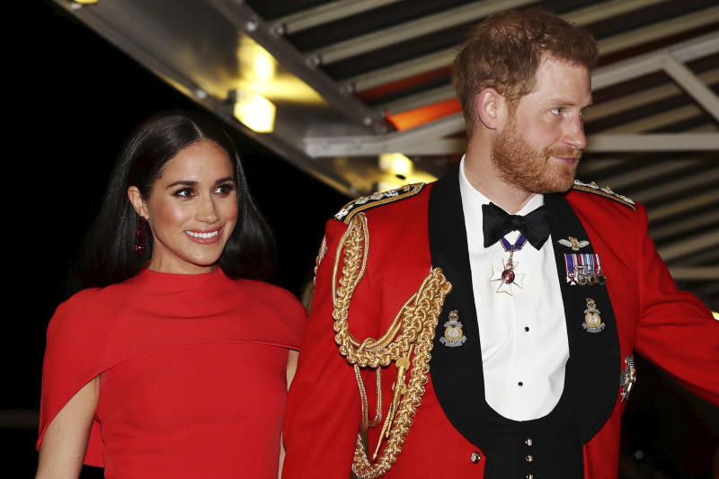 """FILE - In this Saturday March 7, 2020 file photo, Britain's Prince Harry and Meghan, Duchess of Sussex arrive at the Royal Albert Hall in London. Meghan, Duchess of Sussex has her first post-royal job: narrating a Disney documentary about elephants. Disney announced Thursday, March 26 that the duchess is lending her voice to """"Elephant,"""" released April 3 on the Disney+ streaming service. (Simon Dawson/Pool via AP, file)"""