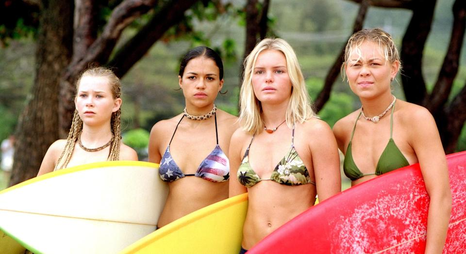 """<p>Hawaii, surfing, and a group of badass women who spend their days on the beach. What more could you ask for in a summer movie? Kate Bosworth, Michelle Rodriguez, and Sànoe Lake (a surfer IRL!) lead this movie that was based on a <a href=""""https://www.outsideonline.com/1926561/lifes-swell"""" rel=""""nofollow noopener"""" target=""""_blank"""" data-ylk=""""slk:1998 Outside magazine article"""" class=""""link rapid-noclick-resp"""">1998 <em>Outside</em> magazine article</a> titled, """"Life's Swell."""" </p> <p><em>Available to rent on</em> <a href=""""https://www.amazon.com/Blue-Crush-John-Stockwell/dp/B002DJO5AW"""" rel=""""nofollow noopener"""" target=""""_blank"""" data-ylk=""""slk:Amazon Prime Video"""" class=""""link rapid-noclick-resp""""><em>Amazon Prime Video</em></a><em>.</em></p>"""