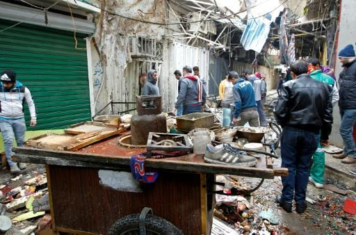 Central Baghdad market blasts kill dozens
