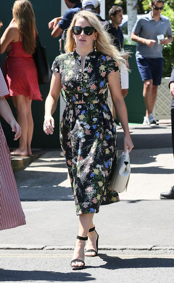 <p>Ellie Goulding attended the first day of Wimbledon in a floral summer-ready dress by Erdem. The singer accessorised the courtside look with a pair of strappy shoes and a One Six One Gaia handbag the Duchess of Cambridge would be proud of. <em>[Photo: Rex]</em> </p>