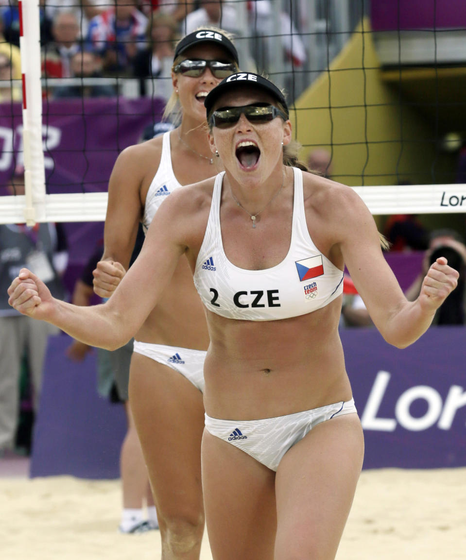 Czech Republic's Marketa Slukova, front, and teammate Kristyne Kolocova react at the end of a 3-2 set win over Austria in a women's beach volleyball match at the 2012 Summer Olympics, Saturday, July 28, 2012, in London. (AP Photo/Dave Martin)