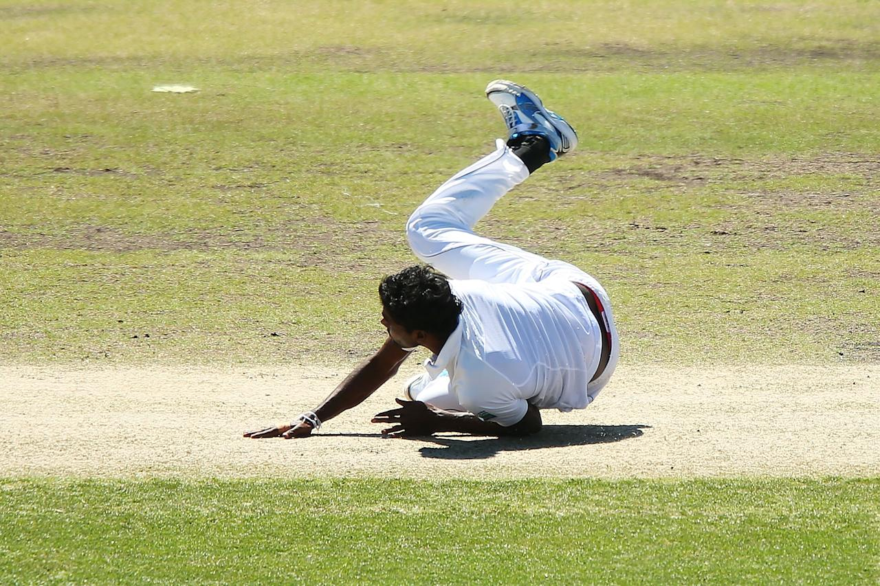 CANBERRA, AUSTRALIA - DECEMBER 06:  Shaminda Eranga of Sri Lanka falls whilst bowling during day one of the international tour match between the Chairman's XI and Sri Lanka at Manuka Oval on December 6, 2012 in Canberra, Australia.  (Photo by Brendon Thorne/Getty Images)