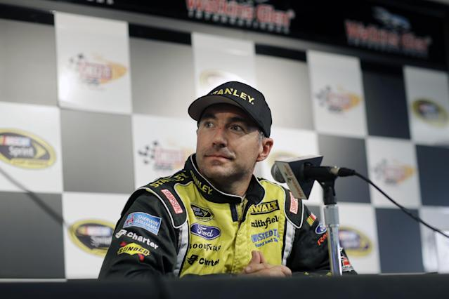 Marcos Ambrose listens to a question during a news conference before a practice session for Sunday's NASCAR Sprint Cup Series auto race at Watkins Glen International, Friday, Aug. 8, 2014, in Watkins Glen N.Y. (AP Photo/Mel Evans)