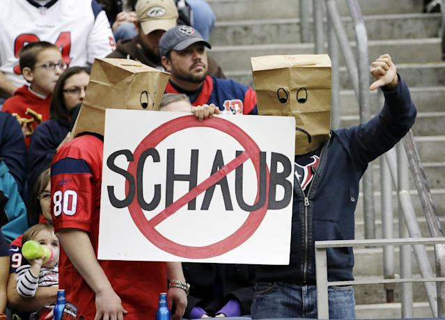 Houston Texans fans holds up a sign during the second quarter of an NFL football game against the Jacksonville Jaguars Sunday, Nov. 24, 2013, in Houston. (AP Photo/David J. Phillip)