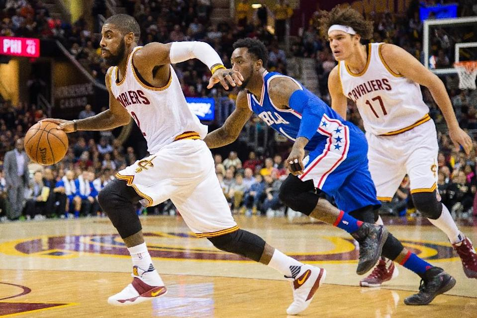Kyrie Irving (L) of the Cleveland Cavaliers drives past Tony Wroten of the Philadelphia 76ers on December 20, 2015 in Cleveland, Ohio (AFP Photo/Jason Miller)