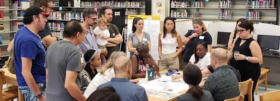 Wynwood Norte residents and property owners huddle with planning consultants during a public workshop in May at Jose de Diego Middle School.