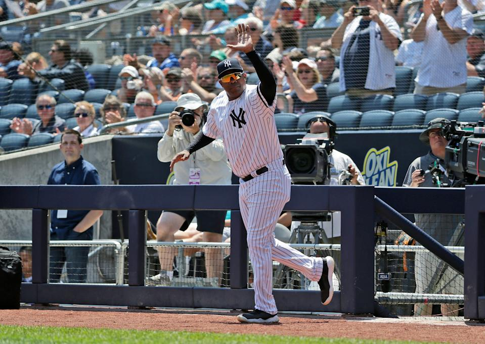Former New York Yankee Marcus Thames is introduced during Old Timer's Day at Yankee Stadium, Sunday, June 23, 2019, in New York.