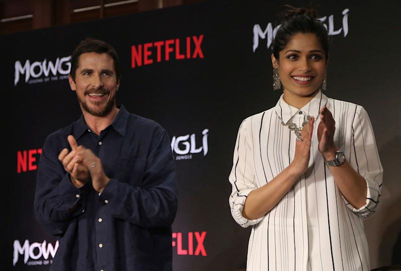 Actors Christian Bale and Freida Pinto on stage at the trailer launch of Netflix's Mowgli in Mumbai, India, on Nov. 25, 2018. (AP/Rafiq Maqbool)