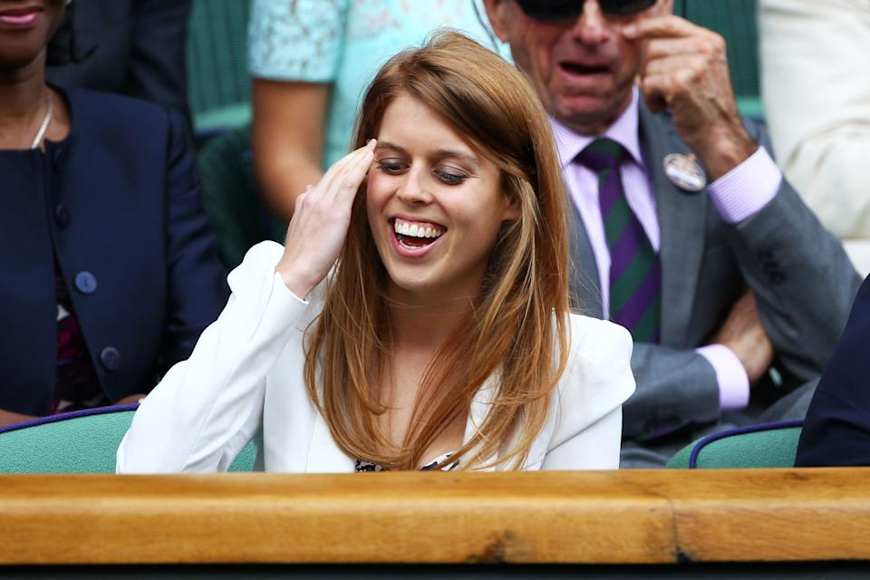 Princess Beatrice makes a rare - but happy - appearance at the tournament in 2011. <em>[Photo: Getty Images]</em>