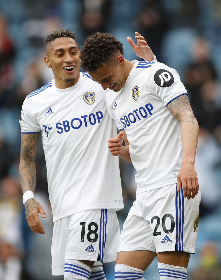 Leeds United's Rodrigo, right, celebrates scoring the opening goal during the English Premier League soccer match between Leeds United and West Brom at Elland Road in Leeds, England, Sunday May 23, 2021. (Lynne Cameron/Pool via AP)