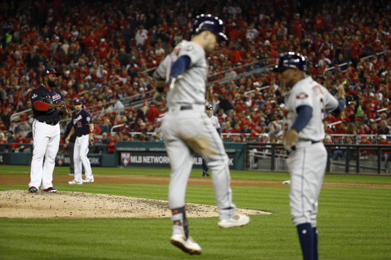 Houston Astros' Alex Bregman rounds the bases after a grand slam off Washington Nationals relief pitcher Fernando Rodney during the seventh inning of Game 4 of the baseball World Series Saturday, Oct. 26, 2019, in Washington. (AP Photo/Patrick Semansky)