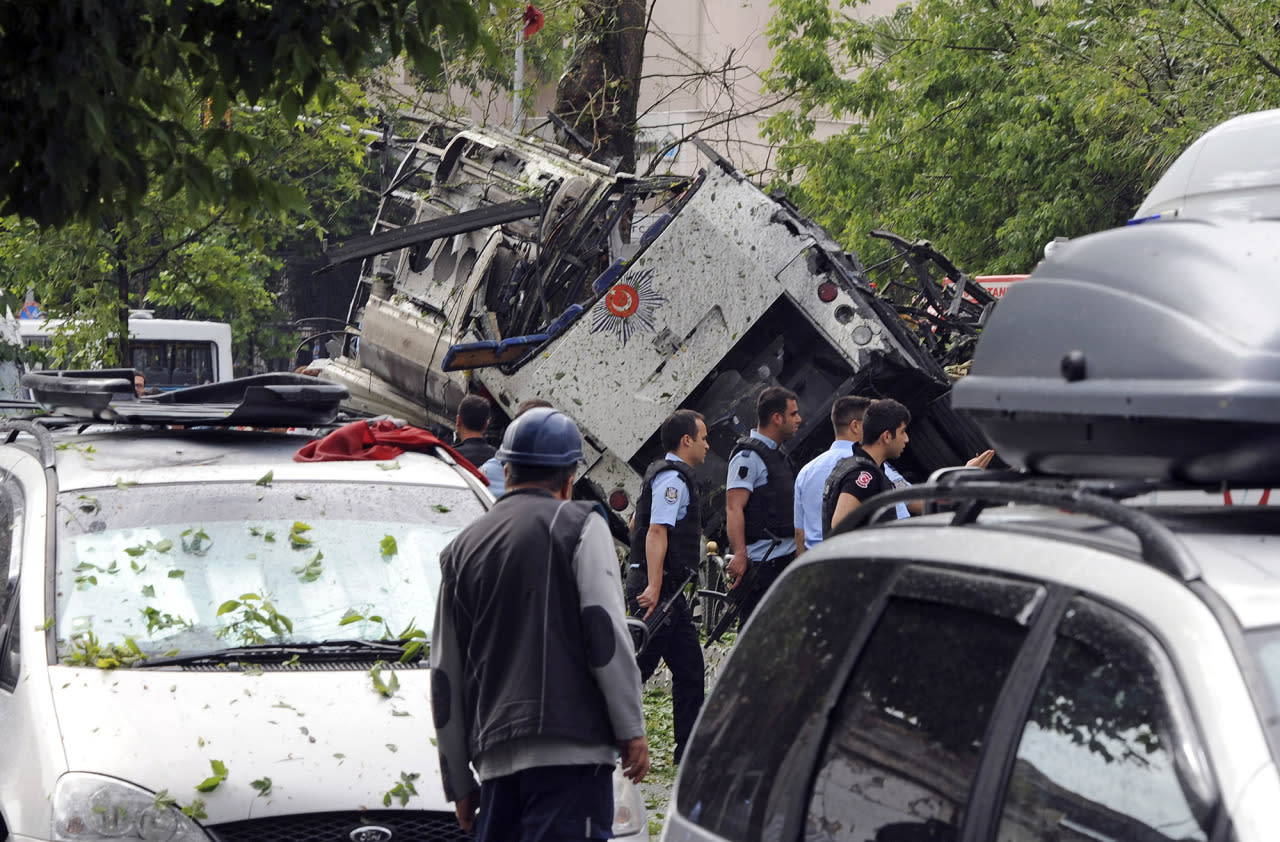 <p>Turkish security officials and firefighters work at the explosion site after a bus carrying riot police official was struck by a bomb in Istanbul, Tuesday, June 7, 2016. At least five police officers were wounded. The blast occurred at a busy intersection near an Istanbul University building in the city's Beyazit district during the morning rush hour. (DHA via AP) TURKEY OUT </p>