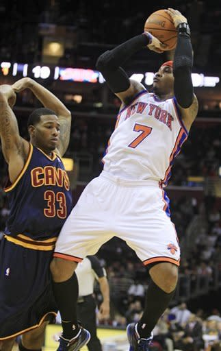New York Knicks' Carmelo Anthony (7) shoots over Cleveland Cavaliers' Alonzo Gee (33) in the first quarter in an NBA basketball game on Wednesday, Jan. 25, 2012, in Cleveland. (AP Photo/Tony Dejak)