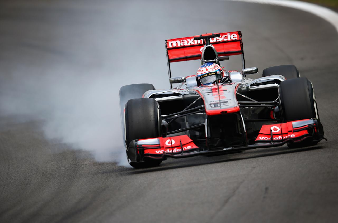 SAO PAULO, BRAZIL - NOVEMBER 24:  Jenson Button of Great Britain and McLaren drives during qualifying for the Brazilian Formula One Grand Prix at the Autodromo Jose Carlos Pace on November 24, 2012 in Sao Paulo, Brazil.  (Photo by Clive Mason/Getty Images)