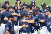 Dallas Baptist's Dominic Hamel (27) and coach Victor Sanchez (57) hug after an NCAA college baseball tournament super regional game against Virginia Monday, June 14, 2021, in Columbia, S.C. Virginia won 5-2 and advances to the College World Series. (AP Photo/Sean Rayford)