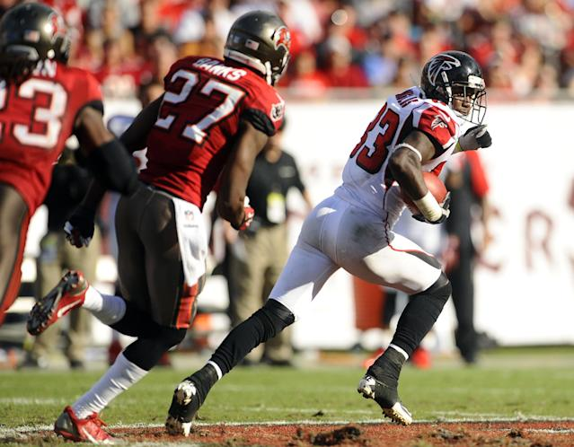 Atlanta Falcons wide receiver Harry Douglas (83) outruns to Tampa Bay Buccaneers cornerback Johnthan Banks (27) and strong safety Mark Barron (23) on an 80-yard touchdown reception during the third quarter of an NFL football game Sunday, Nov. 17, 2013, in Tampa, Fla. (AP Photo/Brian Blanco)