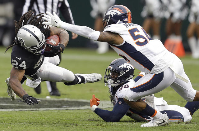 <p>Oakland Raiders running back Marshawn Lynch (24) falls forward next to Denver Broncos linebacker Brandon Marshall (54) and linebacker Von Miller (58) during the first half of an NFL football game in Oakland, Calif., Sunday, Nov. 26, 2017. (AP Photo/Ben Margot) </p>