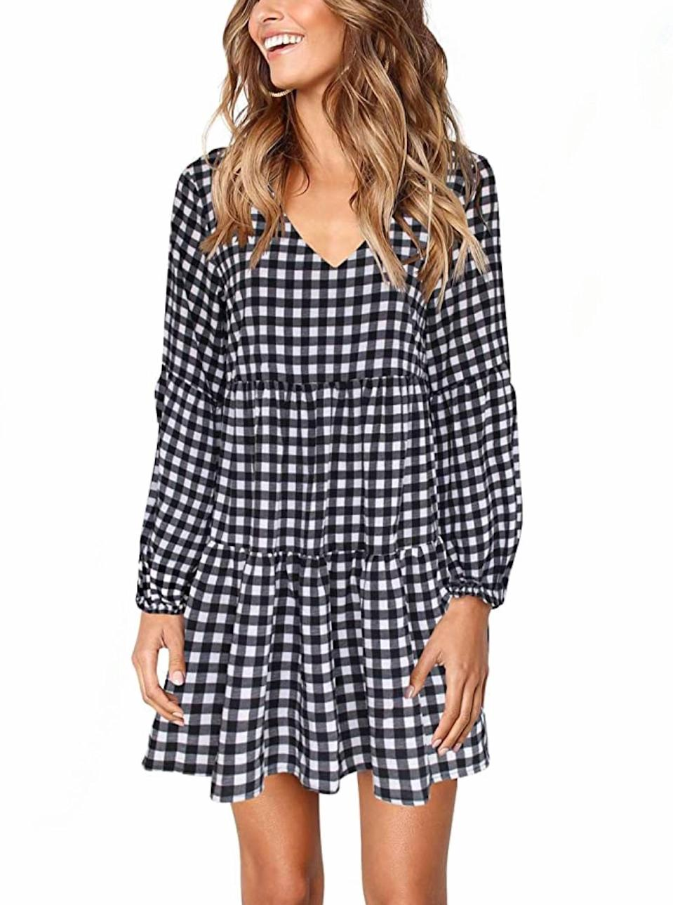 """Get in on gingham with this breezy tiered mini dress that will bring <a href=""""https://www.glamour.com/story/picnic-essentials?mbid=synd_yahoo_rss"""" rel=""""nofollow noopener"""" target=""""_blank"""" data-ylk=""""slk:picnic"""" class=""""link rapid-noclick-resp"""">picnic</a> vibes to the table. $25, Amazon. <a href=""""https://www.amazon.com/Womens-Casual-Shift-Dress-Sleeve/dp/B07Z8R76ZX/"""" rel=""""nofollow noopener"""" target=""""_blank"""" data-ylk=""""slk:Get it now!"""" class=""""link rapid-noclick-resp"""">Get it now!</a>"""