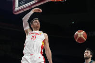Spain's Victor Claver (10) scores against Slovenia during a men's basketball preliminary round game at the 2020 Summer Olympics, Sunday, Aug. 1, 2021, in Saitama, Japan. (AP Photo/Eric Gay)