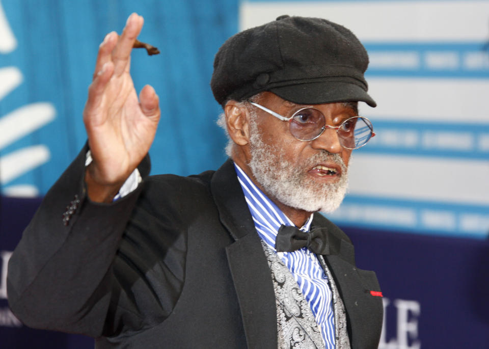 """FILE - U.S director, actor, screenwriter Melvin Van Peebles is seen during a tribute for his career at the 38th American Film Festival in Deauville, Normandy, France, Wednesday Sept. 5, 2012. Van Peebles, a Broadway playwright, musician and movie director whose work ushered in the """"blaxploitation"""" films of the 1970s, has died at age 89. His family said in a statement that Van Peebles died Tuesday night, Sept. 21, 2021, at his home.(AP Photo/Michel Spingler, File)"""