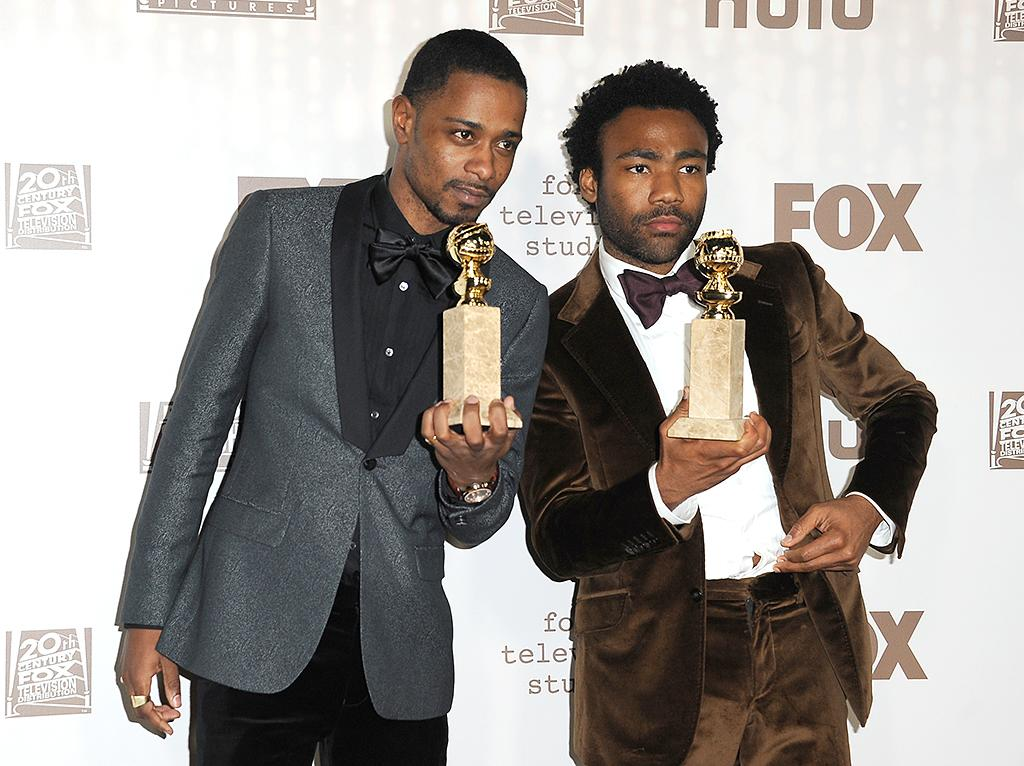 <p><i>Atlanta</i> stars LaKeith Stanfield and Donald Glover held up the Globes they won for Best TV Series, Musical or Comedy, at the bash hosted by Fox and FX. (Photo: Jennifer Lourie/Getty Images) </p>