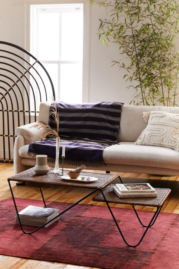 """<p>This asymmetrical <a href=""""https://www.popsugar.com/buy/Maeve-Woven-Coffee-Table-486948?p_name=Maeve%20Woven%20Coffee%20Table&retailer=urbanoutfitters.com&pid=486948&price=399&evar1=casa%3Aus&evar9=45812335&evar98=https%3A%2F%2Fwww.popsugar.com%2Fhome%2Fphoto-gallery%2F45812335%2Fimage%2F46653828%2FMaeve-Woven-Coffee-Table&list1=shopping%2Curban%20outfitters%2Chome%20decor%2Cfurniture%2Crooms&prop13=api&pdata=1"""" rel=""""nofollow"""" data-shoppable-link=""""1"""" target=""""_blank"""" class=""""ga-track"""" data-ga-category=""""Related"""" data-ga-label=""""https://www.urbanoutfitters.com/shop/maeve-woven-coffee-table?category=furniture&amp;color=020&amp;type=REGULAR"""" data-ga-action=""""In-Line Links"""">Maeve Woven Coffee Table</a> ($399) is so dreamy.</p>"""