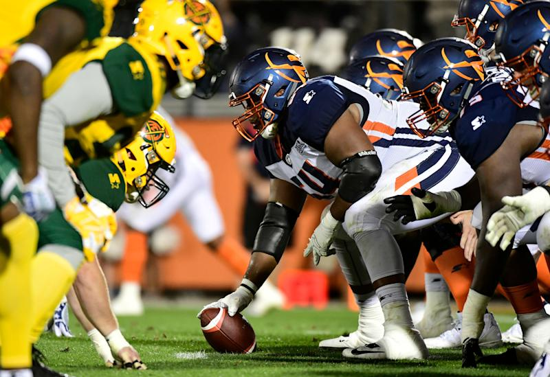 ORLANDO, FLORIDA - MARCH 16: Jordan McCray #64 of the Orlando Apollos prepares to hike the ball during the second quarter of the Alliance of American Football game against the Arizona Hotshots at Spectrum Stadium on March 16, 2019 in Orlando, Florida. (Photo by Julio Aguilar/AAF/Getty Images)