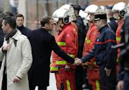 What started out as protests against new fuel taxes has spiralled into a broad opposition front to President Emmanuel Macron (L) and his pro-business economic reforms