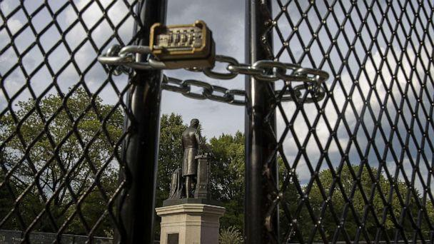 PHOTO: *A locked gate surrounds the Emancipation Memorial debate in Lincoln Park, June 26, 2020, in Washington, D.C., to protect it as controversy and protests erupted around monuments that many find offensive. (Tasos Katopodis/Getty Images)