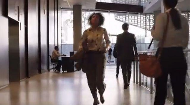 A woman races to get in the lift. Source: YouTube