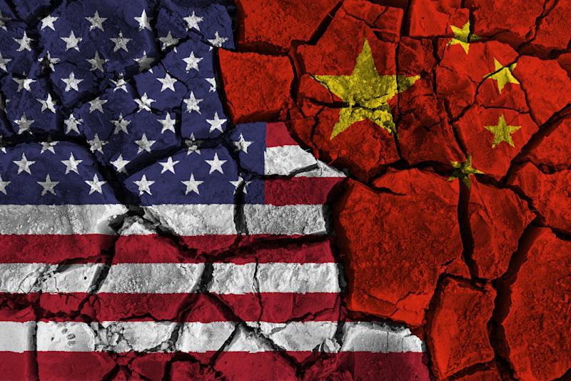 Trade war between United states of america VS China . flag on cracked wall background . Confliction and crisis concept .