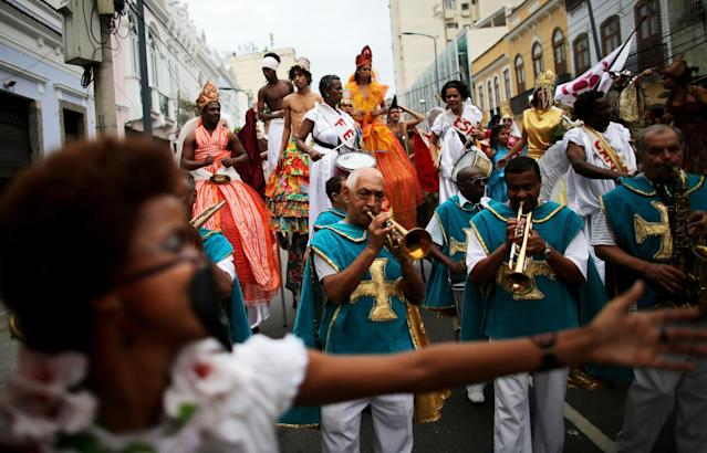 RIO DE JANEIRO, BRAZIL - NOVEMBER 01: Participants march in an All Saints' Day parade, the day before the Day of the Dead, in the port district on November 1, 2013 in Rio de Janeiro, Brazil. Brazilians will mark the Day of the Dead tomorrow by visiting the graves of loved ones throughout the country. (Photo by Mario Tama/Getty Images)