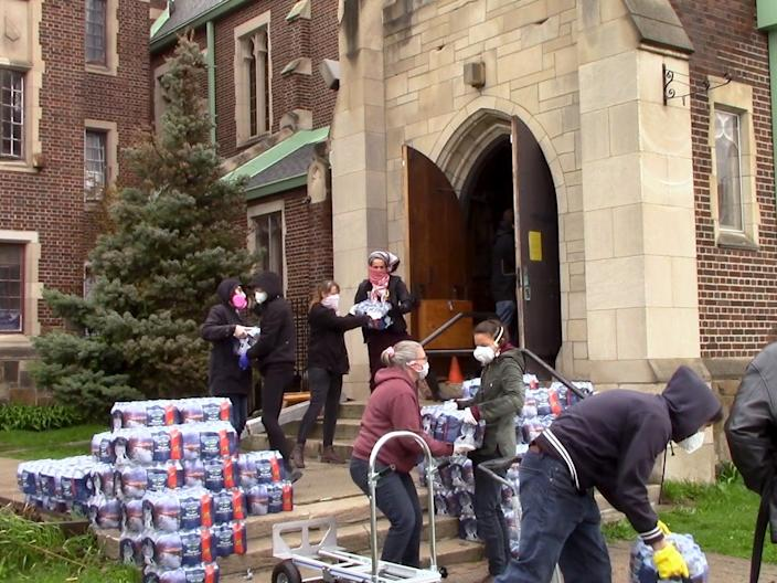 Volunteers with We the People of Detroit gather bottled water to distribute to residents without access to safe drinking water.