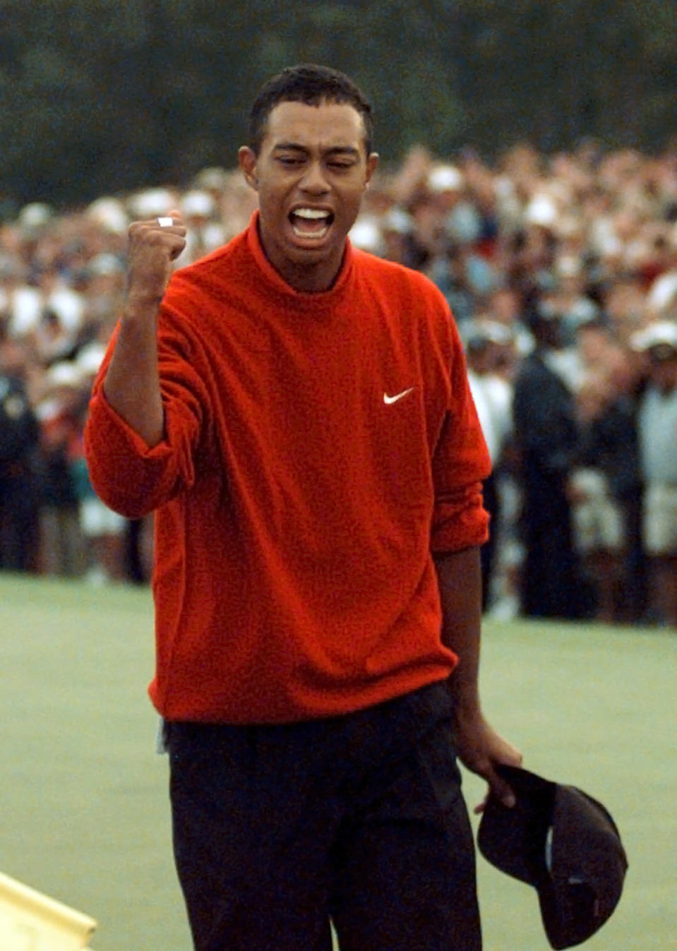 <p>1997 Masters champion Tiger Woods celebrates as he leaves the 18th green after winning the Masters at the Augusta National Golf Club in Augusta, Ga., Sunday, April 13, 1997. (AP Photo/ Dave Martin) </p>