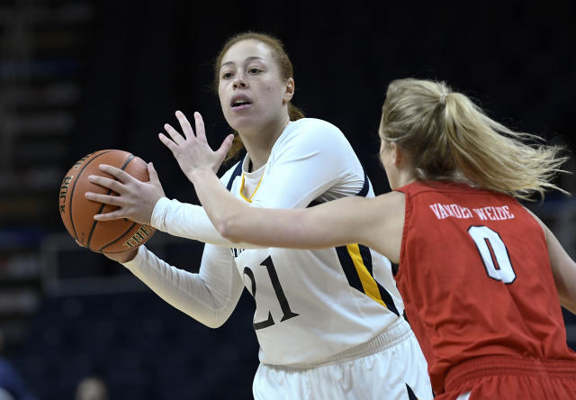FILE - In this Monday, March 11, 2019, file photo, Quinnipiac forward Jen Fay (21) looks to pass as Marist guard Grace Vander Weide (0) defends during the first half of an NCAA college basketball game in the Metro Atlantic Athletic Conference women's tournament in Albany, N.Y. This 6-foot fifth-year senior scored 20 points in an NCAA Tournament victory over Marquette two years ago during Quinnipiacs Cinderella run to a regional semifinal. (AP Photo/Hans Pennink, File)