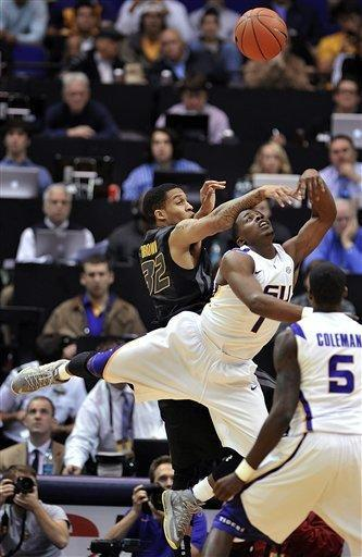 Missouri guard Jabari Brown (32) blocks the shot of LSU guard Anthony Hickey (1) as teammate Shavon Coleman (5) watches during the first half of an NCAA college basketball game at the Pete Maravich Assembly Center in Baton Rouge, La., Wednesday, Jan. 30, 2013. (AP Photo/Bill Feig)
