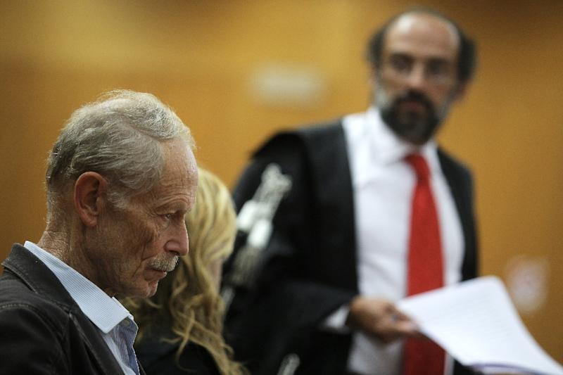 """Italian writer Erri De Luca, accused of inciting crime by saying in an interview that the controversial high-speed rail-link through the Alps """"should be sabotaged"""", looks on during his trial, on September 21, 2015 in Turin (AFP Photo/Marco Bertorello)"""