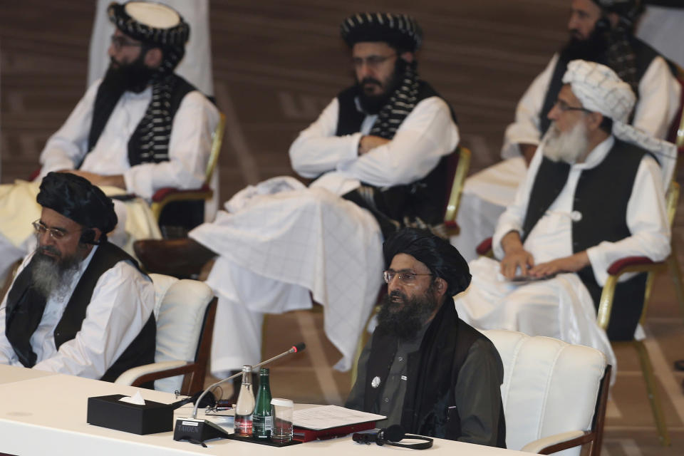 FILE - In this Sept. 12, 2020, file photo, Taliban co-founder Mullah Abdul Ghani Baradar, bottom right, speaks at the opening session of peace talks between the Afghan government and the Taliban in Doha, Qatar. Russia is to host on Thursday, March 18, 2021, the first of three international conferences aimed at jump-starting a stalled Afghanistan peace process ahead of a May 1 deadline for the final withdrawal of U.S. and NATO troops from the country. (AP Photo/Hussein Sayed, File)