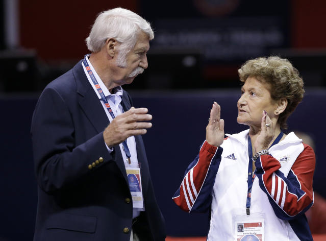 USA Gymnastics national team director Martha Karolyi, standing with her husband Bela, was reportedly informed about Larry Nassar's abuse at their training ranch in June 2015. (AP Photo/Gregory Bull)