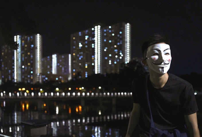 A protester wears a mask in Hong Kong, Friday, Oct. 18, 2019. Hong Kong pro-democracy protesters are donning cartoon/superhero masks as they formed a human chain across the semiautonomous Chinese city, in defiance of a government ban on face coverings. (AP Photo/Vincent Yu)