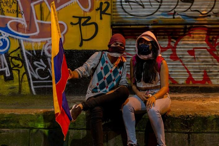 Two women pose for a photo during a protest in Medellín on 19 May 2021