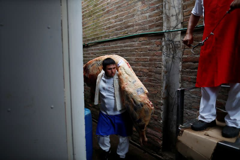 A butcher stores a cattle carcassin a butcher shop during the coronavirus disease (COVID-19), at wholesale food market Mercado Central (central market), in La Matanza, on the outskirts of Buenos Aires