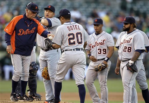 Detroit Tigers manager Jim Leyland, left, gives the ball to pitcher Octavio Dotel (20) during the seventh inning of a baseball game against the Oakland Athletics, Saturday, May 12, 2012, in Oakland, Calif. (AP Photo/Ben Margot)