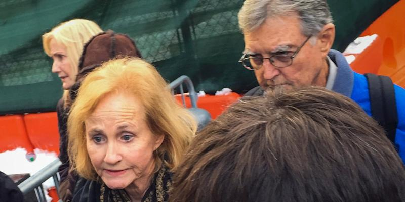 Lyn and Kirk Ulbricht (back R), parents of Ross Ulbricht, speak to journalists after his conviction in Lower Manhattan, New York February 4, 2015. The suspected mastermind behind the underground website Silk Road was convicted on narcotics and other charges on Wednesday for his role in orchestrating a scheme that enabled around $200 million of anonymous online drug sales using bitcoins. Ross Ulbricht, 30, was found guilty by a Manhattan federal jury on all seven counts he faced after a closely watched four-week trial spilling out of U.S. investigations of the use of the bitcoin digital currency for drug trafficking and other crimes.