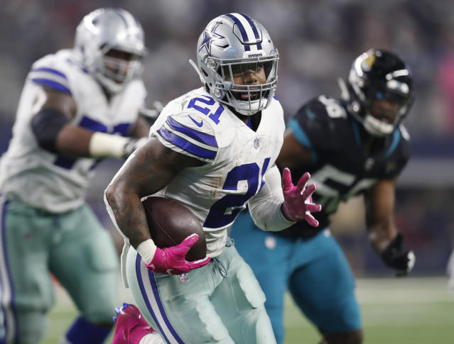 FILE - In this Oct. 14, 2018, file photo, Dallas Cowboys running back Ezekiel Elliott (21) carries past Jacksonville Jaguars defensive end Dante Fowler (56) into the end zone for a touchdown in the second half of an NFL football game, in Arlington, Texas. After having one the worst run defense in the NFL last season, the Washington Redskins have improved in that area enough that they go into a matchup against the Dallas Cowboys feeling confident they can contain Ezekiel Elliott and Dak Prescott. (AP Photo/Jim Cowsert, File)