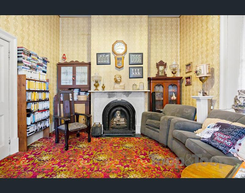 Sitting room inside the Macgill 'creepy' house for sale. (Image: realestate.com.au/Toop & Toop)